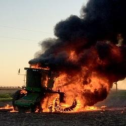 photo of a combine engulfed in flames