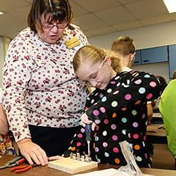 Melva Stamberger, Purdue Extension-Fulton County Educator, works with fourth-graders to provide them