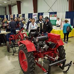 Indiana Small Farm Conference participants looking at small tractor