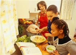 Mother and daughters prepare Thanksgiving dinner