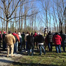 Crowd at field tour during tree clinic workshop.