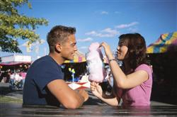 Man and woman eating cotton candy