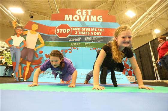 children working out at Be Heart Smart exhibit