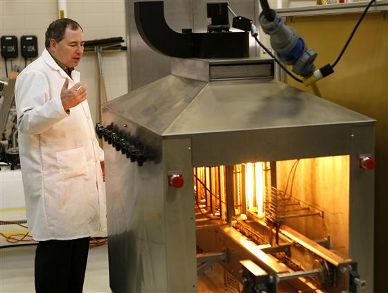 Kevin Keener, a Purdue professor of food science, demonstrates his radiant fryer in a campus lab. (P
