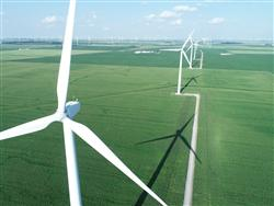Aerial view of field with wind turbines