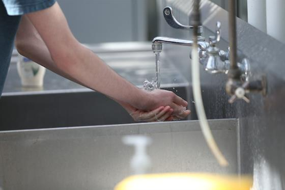 Hand washing in sink