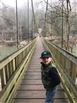 Boy walks on bridge