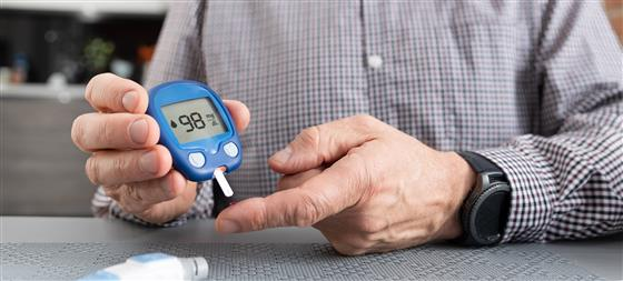 Person with Diabetes performs sugar test