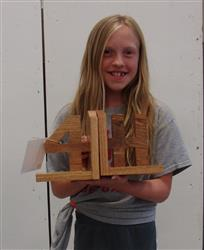 4-H member and woodworking exhibit