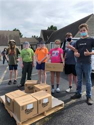 4-H Jr. Leaders Help Distribute Food Boxes