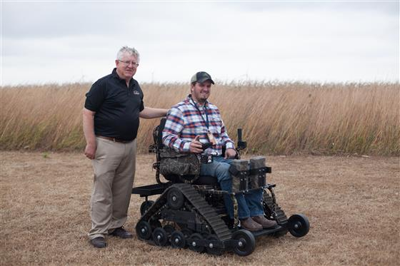 Bill Field, professor and project director of the National AgrAbility Project, is shown with Evan Cr