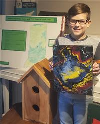 Clinton shows off his completed 4-H projects