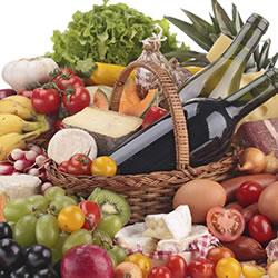 Fruit, vegetable and wine arrangement