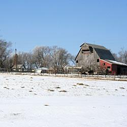 picture of a small farm in winter