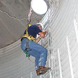 Man climbing in grain elevator safely
