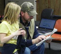 Dad assisting to pick out projects for 4-H.