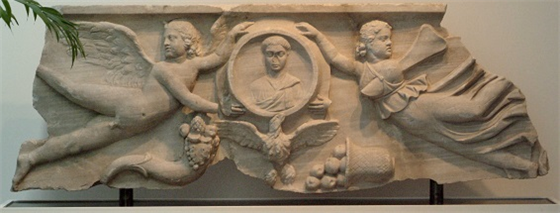 photo of a 4th century Roman marble sarcophagus panel featuring Cupid and Psyche
