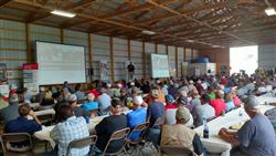 Producers listening to an economic outlook at Pinney Purdue Field Day